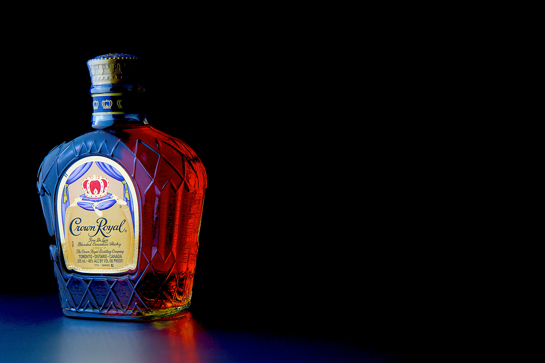 Bottle-of-Crown-Royal-on-Table-