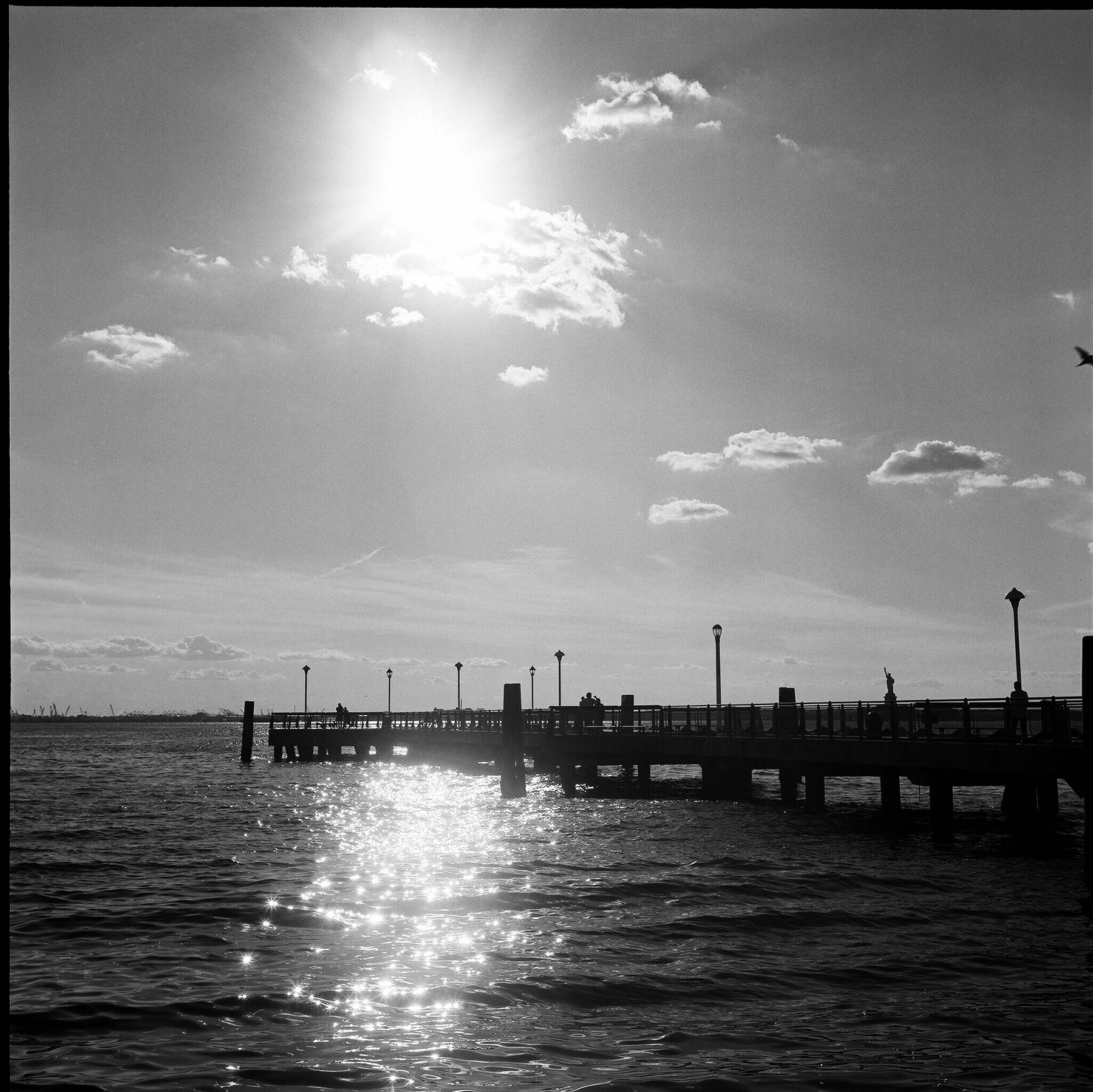 Red-Hook-waterfront-pier-with-sunlight-on-water