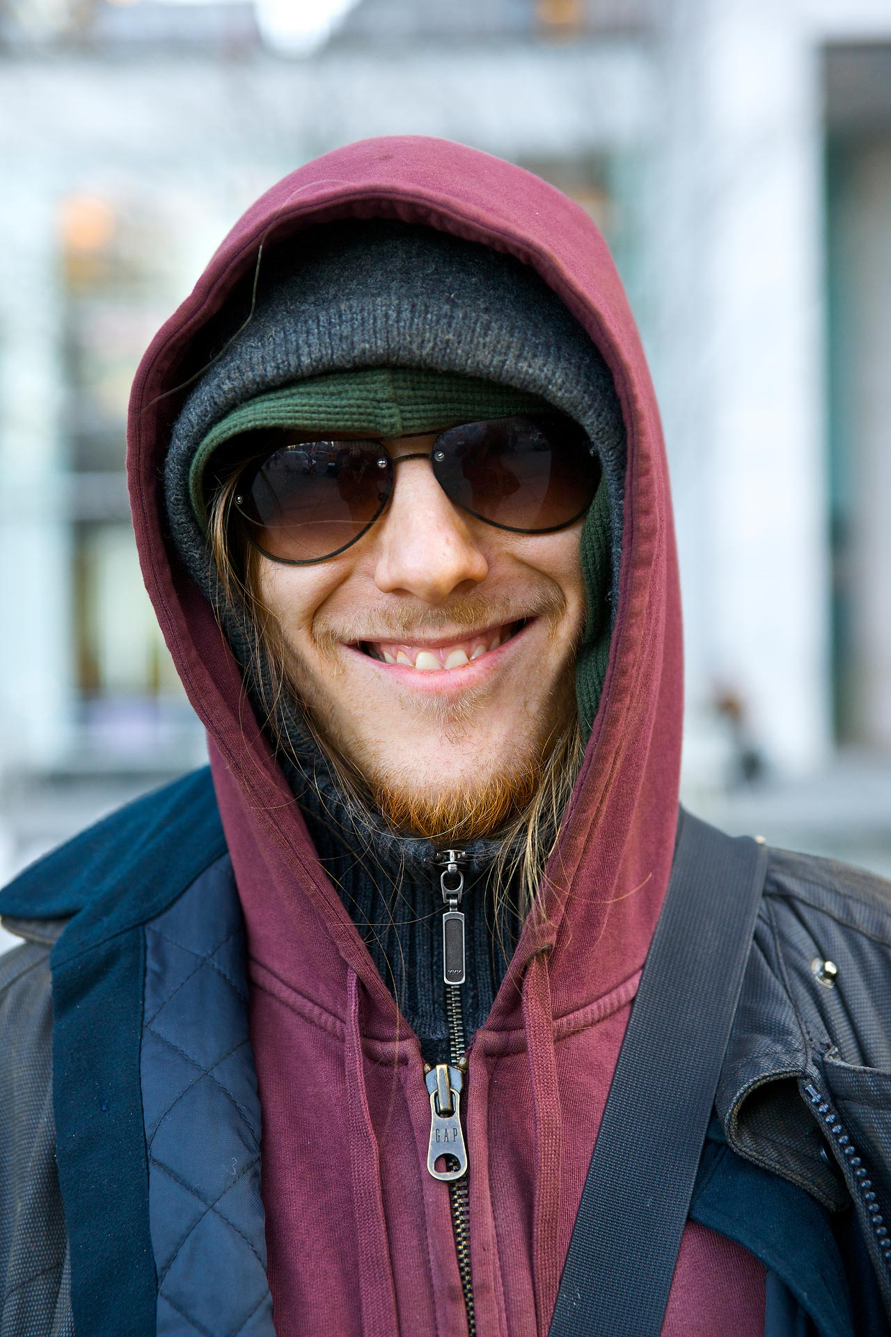 Zach Roman in hoodie in front of Apple Store.jpg