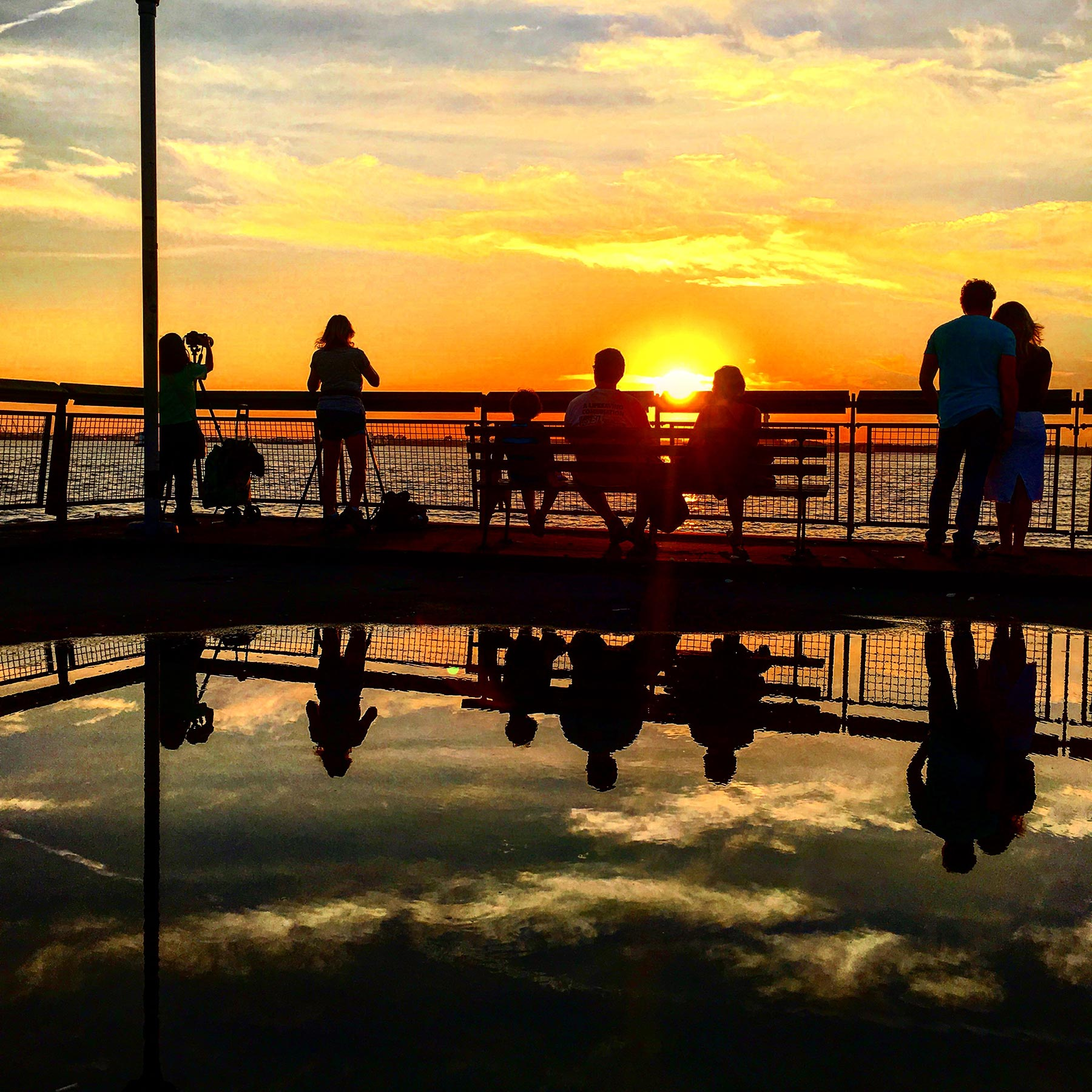 Sunset-at-Valentino-Pier-with-Reflection-of-People-watching-sunset