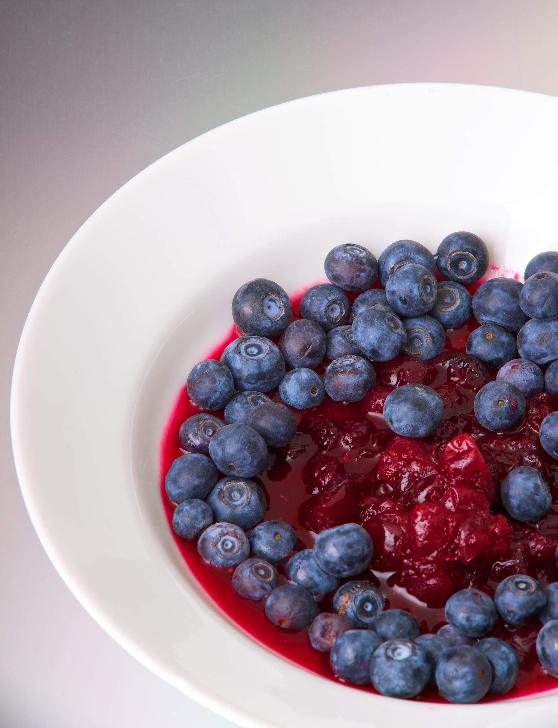 white ceramic bowl with fresh blueberries and cranberries.jpg