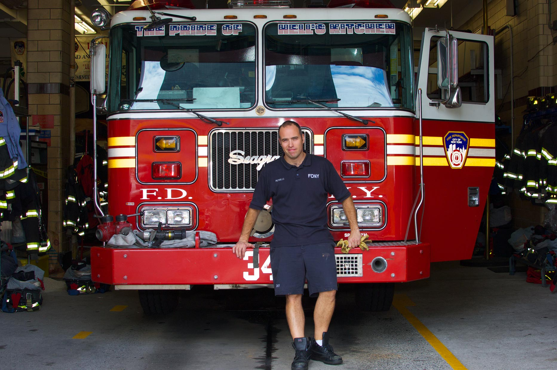Patrick_FDNY_Fireman_In_Front_of_Fire_Engine in Manhattan.jpg