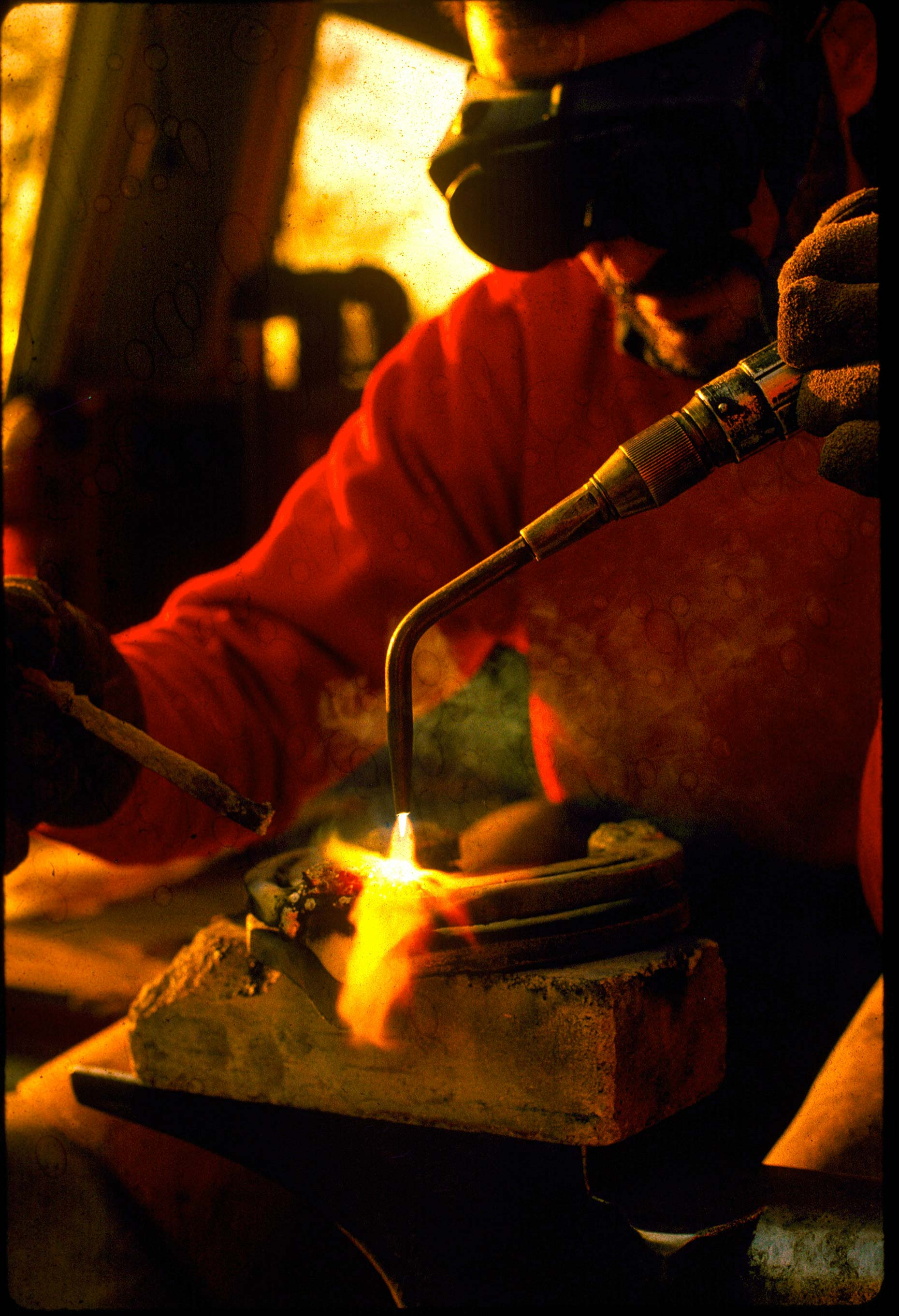 blacksmith_welding_Hot_Shoe _on Horseshoe_Anvil.jpg