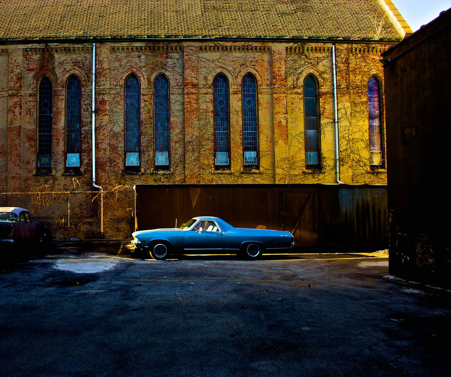 Old blue Chevy El Camino in Parking Lot of Red Hook Brooklyn Parking  Lot.